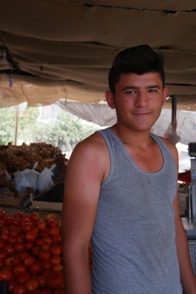 I wanted to buy some fruits and this young vendor offered me tomatoes for free. 'Because you're my sister' he said. Soooo sweet #Turkey