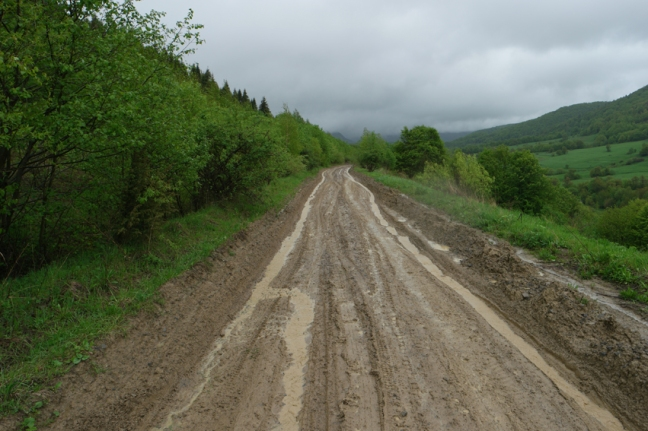 Mud roads are part of the fun #cycling #pushing #Ukraine