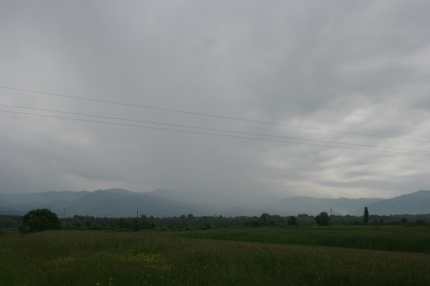 That mountain under that grey rain cloud in the middle… that's my mountain to be climbed. #Romania