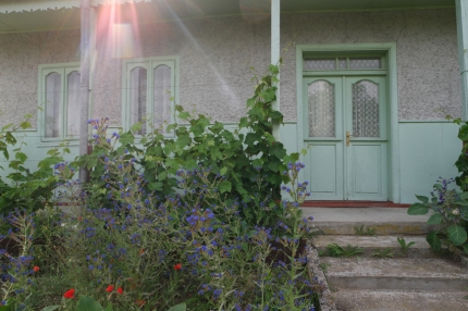 Her house was so cute, I really liked all her flowers, fruit and vegetables around #Danube Delta #Romania