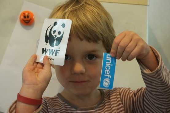 Cute little Vlad was very pleased to receive a WWF and UNICEF sticker #Romania