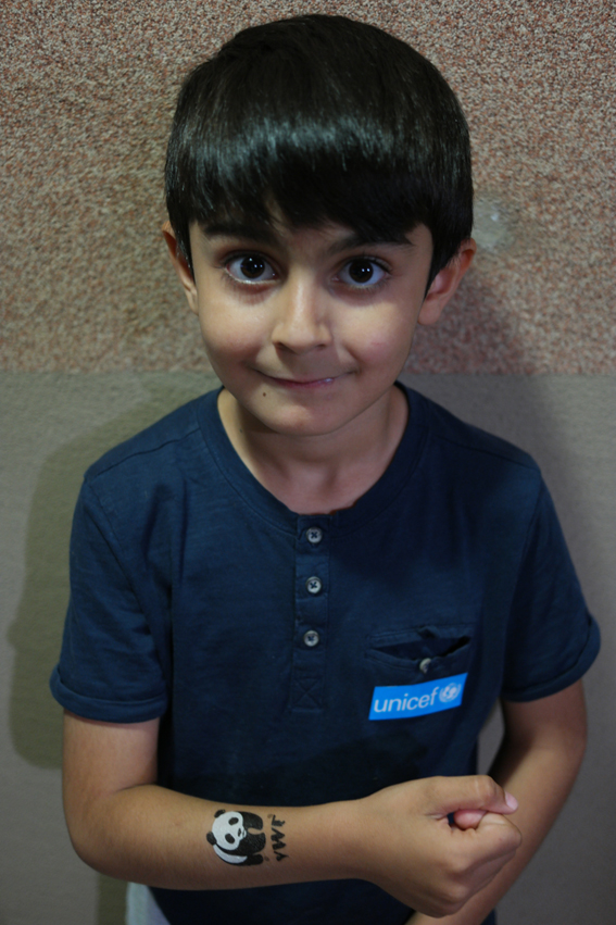 Hasan-Dogu (6,5) was a real expert with the WWF tattoos. He sticked it himself on his arm and couldn't wait to stick one on the other arm. He also found a nice spot to put the UNICEF sticker on. One more happy child #Turkey