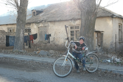 It was around 3 pm when I arrived in the small mountain village of Lusashogh. It was -4ºC and this little boy was cycling around without gloves or jacket. He hadn't cold at all. He liked his bell and used it a lot :) I offered him a ride on my bicycle, which he liked too. He called his mom and instantly the whole family came outside and was watching their little boy riding a heavy loaded touring bike #Armenia