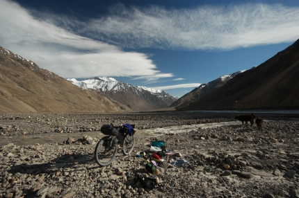 Crossing the river turned out in almost losing my bike. The current was super strong, the water deep and freezing cold. All in once my bike flipped and floated on the river. Help! #khudara #tajikistan