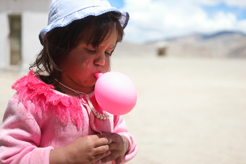 This cutie pie was crying when I first noticed her, offering her a balloon, made her instant happy #bulunkul #tajikistan