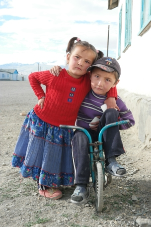 This little boy picked a flower (or rather some weed) for the girl. Isn't that too sweet? #karakol #tajikistan